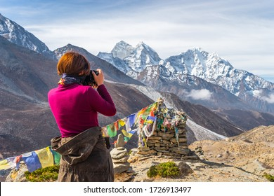 A photographer taking picture of Himalaya mountains, Everest region in Himalaya mountain range in Nepal, Asia