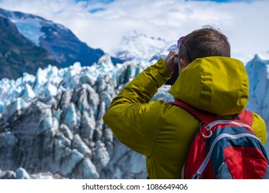 Photographer taking a picture of the ice of glacier. Perito Moreno Glacier, Los Glaciares National Park, Argentina