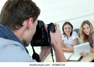 Photographer taking pictures of models