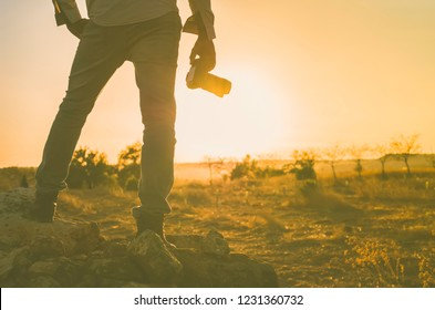 photographer taking pictures at sunset. Image with copy space.