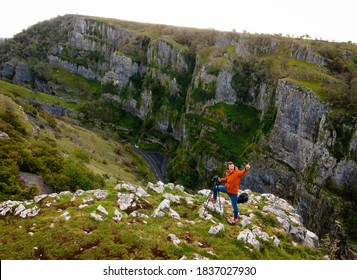 Photographer taking shots of limestone Cheddar Gorge in the Mendip Hills, near the village of Cheddar, Somerset, England