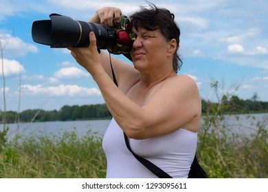 Photographer with telephoto lens