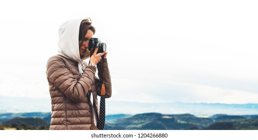 photographer traveler on mountain, tourist looking holding in hands digital photo camera, hiker taking click photography, girl enjoy nature panoramic landscape in trip, relax holiday hobby concept