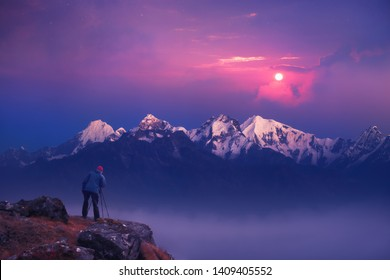 Photographer traveler who take a picture of mountains range enjoying sunrise  of over snowy mountains in the Himalayas, nation park Langtang, Nepal. Night colorful landscape.