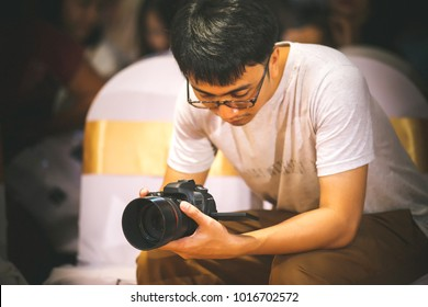 Photographer and video maker man hold DSLR camera on his hand to making footage. video production artist concept. image for objects, article, copy space and illustration.