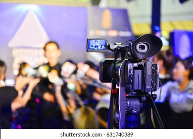 Photographer video recording activity, Lots of television cameras in a row broadcasting a live media event.