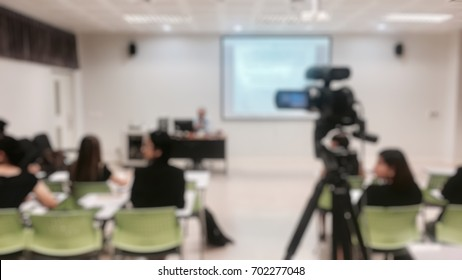 Photographer video recording lecturer and business people learning marketing plan in classroom of university. - Business education or seminar concept blur image use for background.