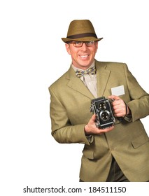 Photographer in vintage retro clothing holding old camera isolated