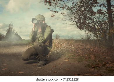 Photographer in war conflict field zone taking pictures