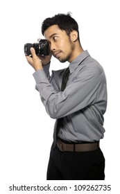 Photographer wearing shirt and tie take photo isolated over white background