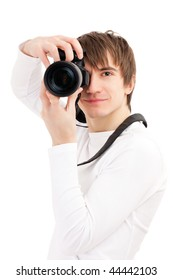 Photographer in white holding phone camera. Isolated over white