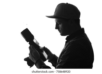 The photographer at work with camera and large lens. Monochrome. Black and white.