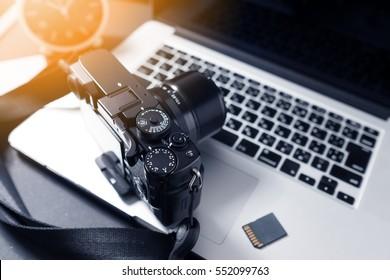 Photographer Workstation. Modern Digital DSLR Camera, Laptop and accessory.