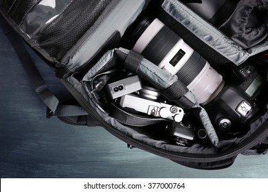 Photographer's equipment on a dark blue background