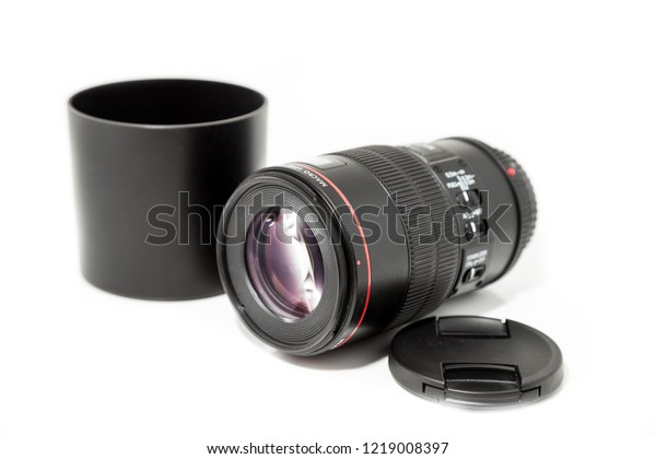 A photographer's lens in front of white Background