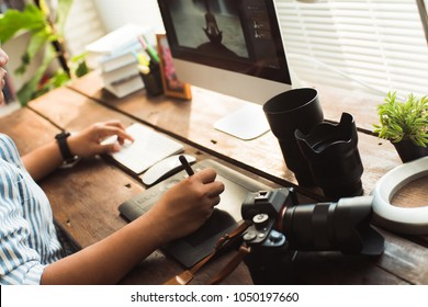 Photographers are retouching photos in the studio.