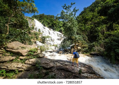 Photographers are shooting waterfalls - Mae Ya waterfall  at Doi Inthanon National Park  chiangmai povince , landscape Thailand