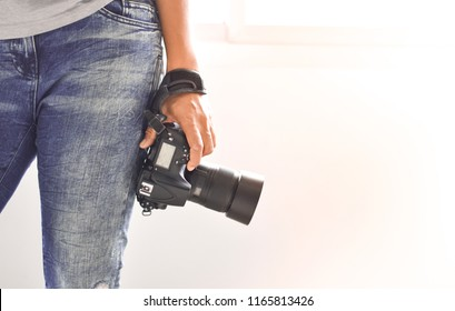 Photographers stand ready to work and Photography is happiness. In the photographer's hand there is a camera.