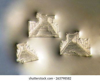 Photographic image of microscopic table salt crystals illuminated by white LED light and magnified 25x