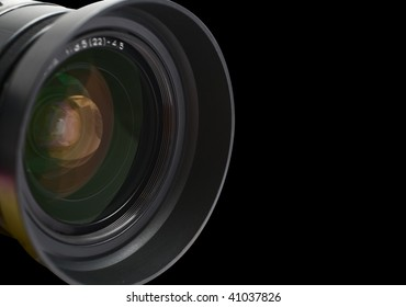 Photographic lens closeup on the black background
