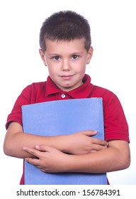 photographic portrait of a schoolboy with red sweater and a blue folder on a white background