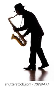A photographic silhouette of a saxophone player into the moment