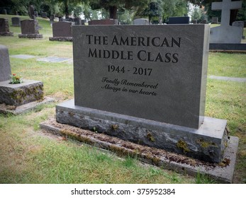 Photograph/illustration/artist conception of headstone in a cemetery noting the demise of the American middle class.