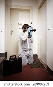 Photographing criminologist technician