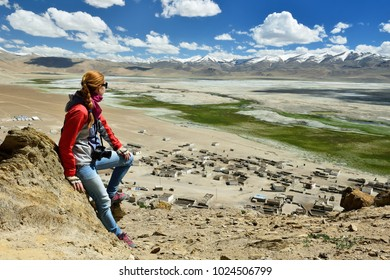 Photographing tourist the Tso Kar Lake in the Karakorum, Leh, India. This region is a purpose of motorcycle expeditions organised by Indians