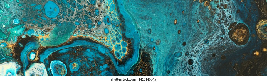 photography of abstract marbleized effect background. Blue creative colors. Beautiful paint with the addition of gold
