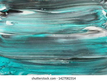 photography of abstract marbleized effect background. black, turquoise and white creative colors. Beautiful paint.