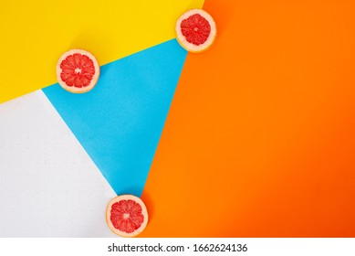 Photography of artistic product. Grapefruits in background of colors and figures.
