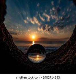 Photography ball/ crystal ball sunrise on coquina rock at Washington oaks Florida in palm coast