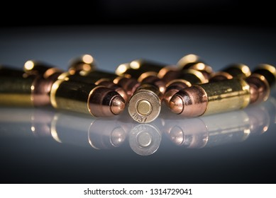 Photography of Bullets of the 9 mm parabellum. With reflection. the number 1937 is the year of the bombing of Guernica Spain.