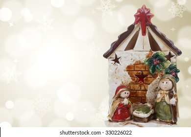 Photography of a Christmas nativity scene with the Virgin Mary, St. Joseph and baby Jesus on a golden bokeh background. Stock photography.