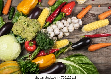 Photography of different vegetables on wooden table.
