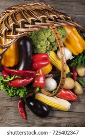 Photography of different vegetables on wooden table in basket