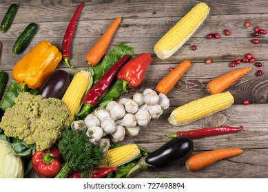 Photography of different vegetables on wooden table. Healthy food background