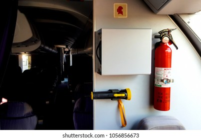 Photography of emergency equipment in aircraft at exit door.