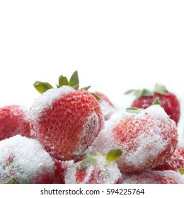 Photography frozen strawberry on white background. Detailed seeds ripe red strawberries with green leaves, ice snowflakes texture. Soft focus, copy space.