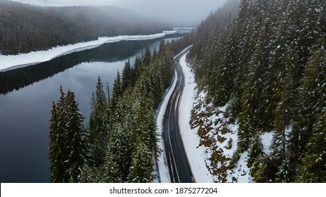 Photography from a high angle of a road near a mountain lake