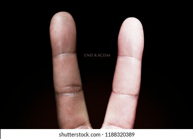 Photography idea showing a black and white finger making a peace sign against racism.