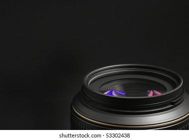 Photography - lens on black background