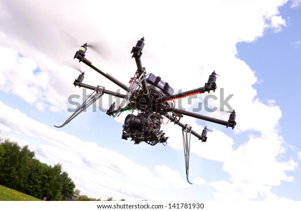 A photography multirotor helicopter with SLR camera attached