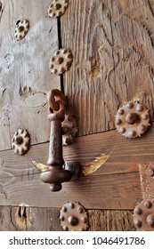 photography of old wood textures with rusty iron rivets, old doorknocker, on the door of the Alcántara bridge in Toledo, Spain, old craft of blacksmith craftsman, cabinetmaker and carpenter