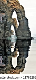 photography with reflection in the water of the famous stone arches of the beach of the cathedrals, galicia, spain,peace, harmony, tranquility, serenity, meditation, transcendence, relaxation, balance