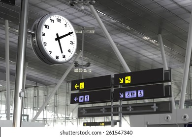 Photography of the signs and the clock at an airport in Santiago de Compostela, Spain.