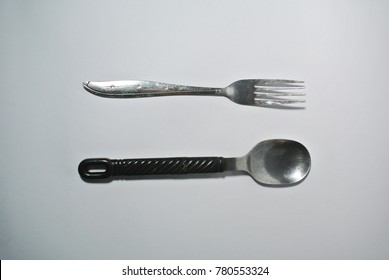 Photography of spoon and fork objects on the white background