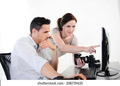 photography student and teacher viewing and editing photos with digital camera and computer