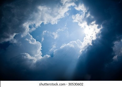 A photography of sun rays and dark clouds